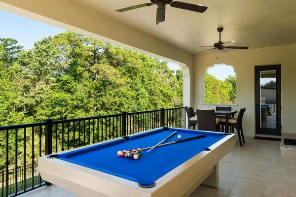 Play a game of pool and enjoy the view from the patio balcony with direct access to the game room