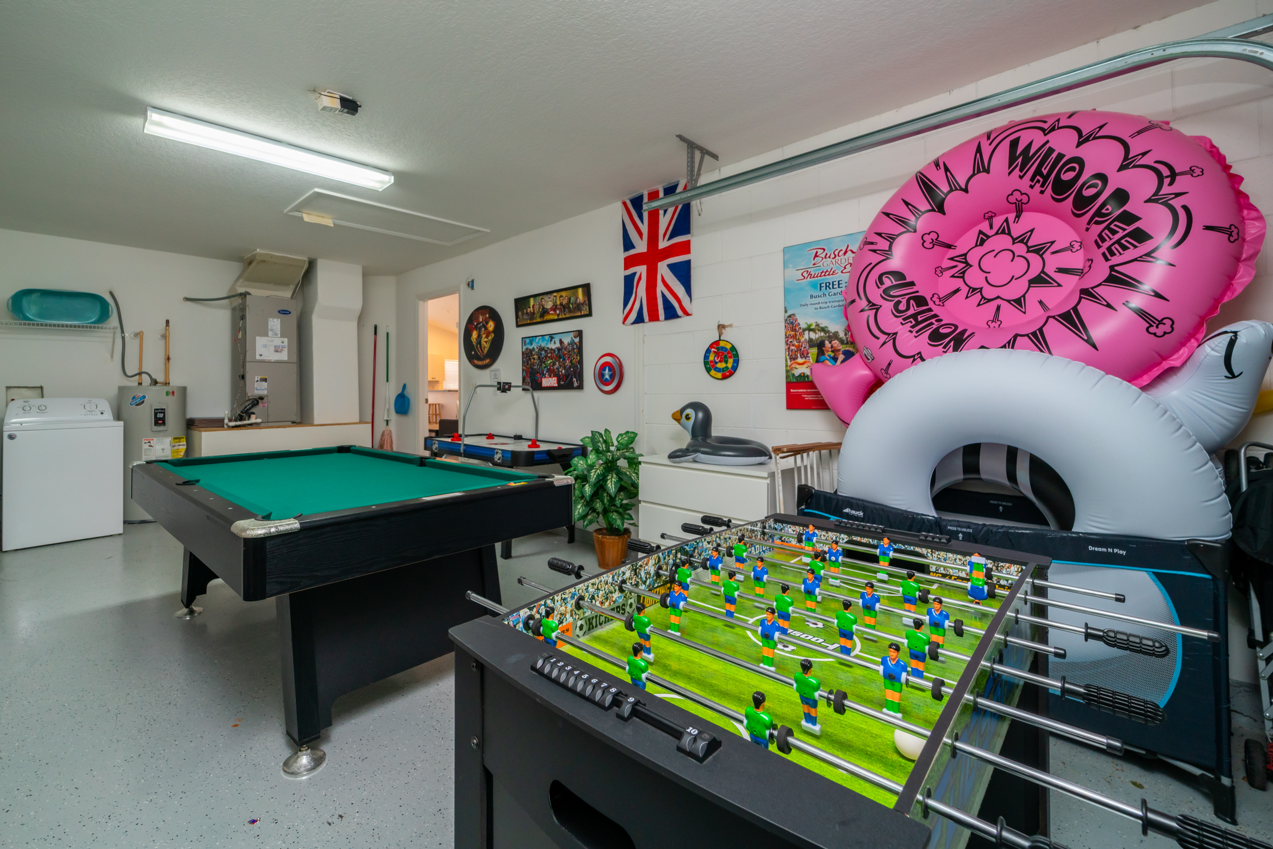 Games room with air hockey and foosball - pool toys are sometimes left by previous guests