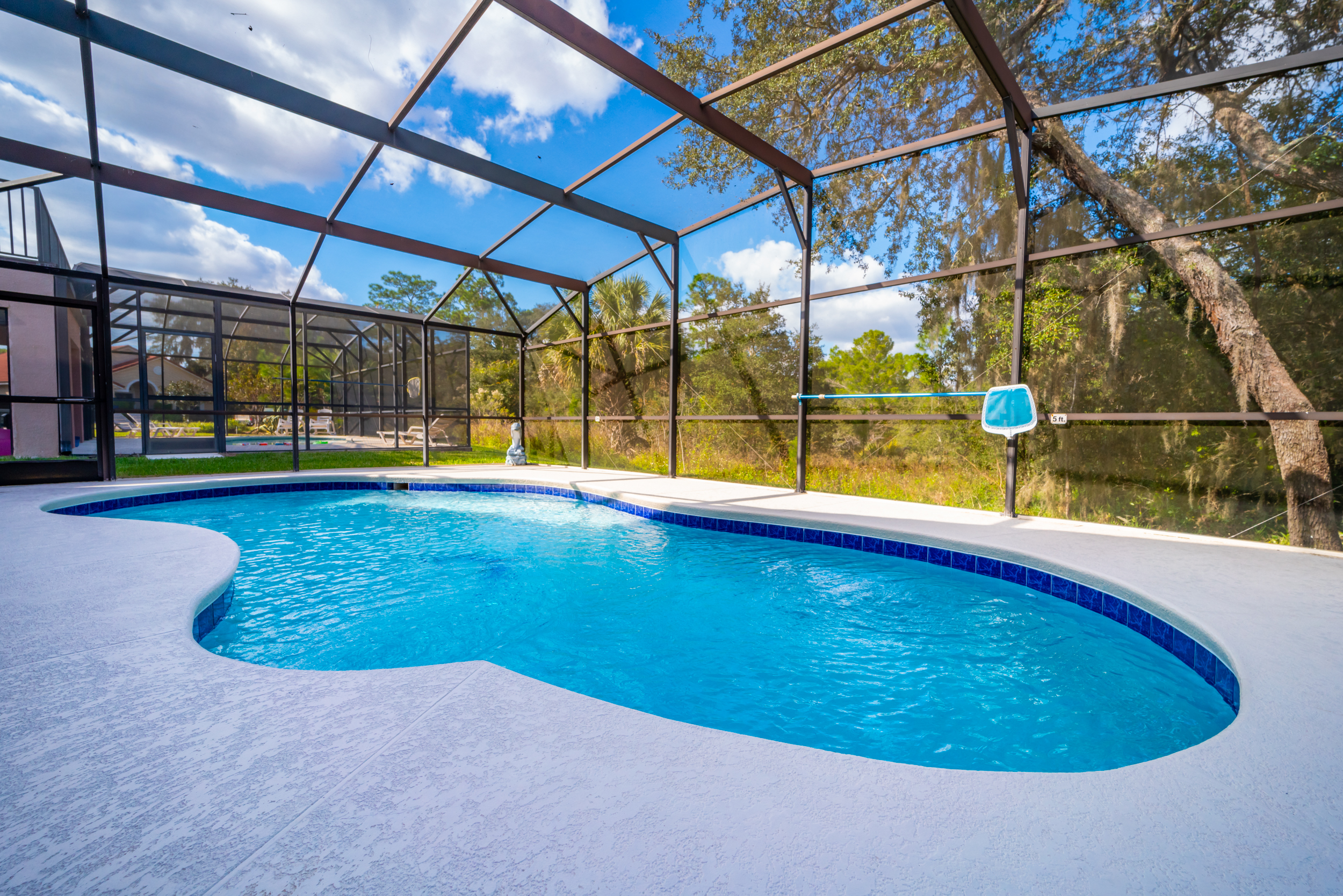 pool deck with screened enclosure