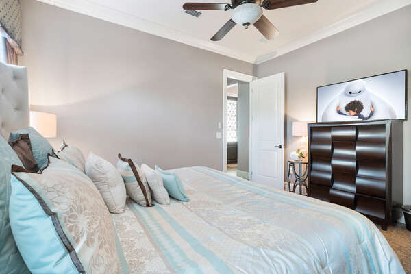 The master bedroom features a 50-inch SMART TV and en-suite bathroom