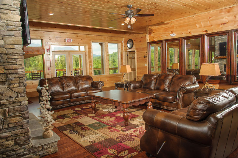 Sofas, Coffee Table, Side Tables, Lamps, and Window Doors to the Deck.