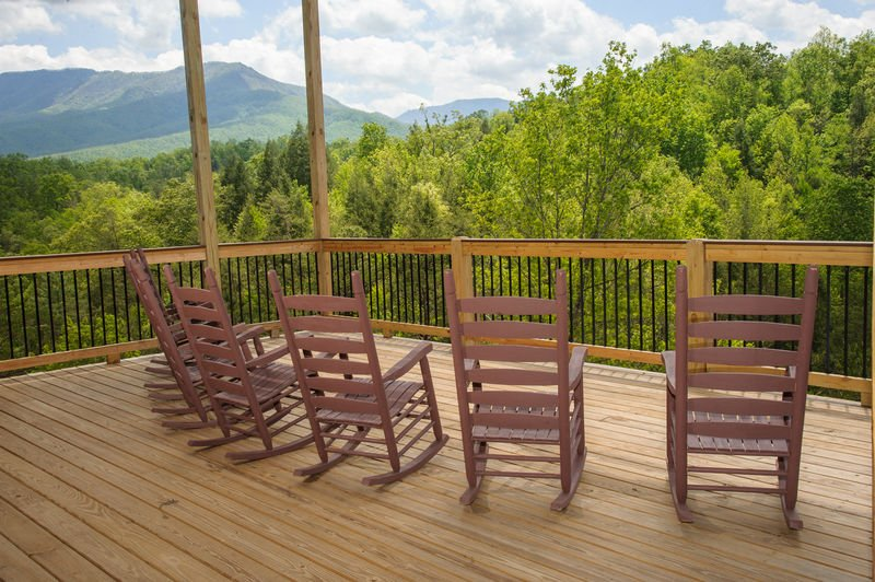 Many Rocking Chairs in the Deck with Mountain View.
