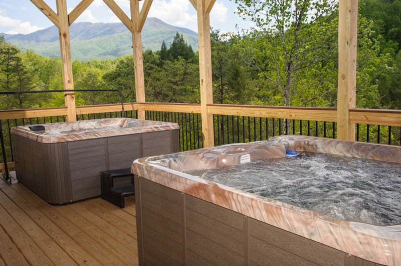 Two Hot Tubs in the Upper-Level Deck with Mountain View.