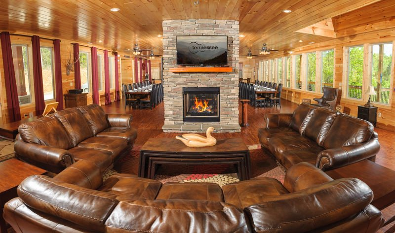 Sofas, Coffee Table, Fireplace, TV, Ceiling Fans, Tables, and Chairs.