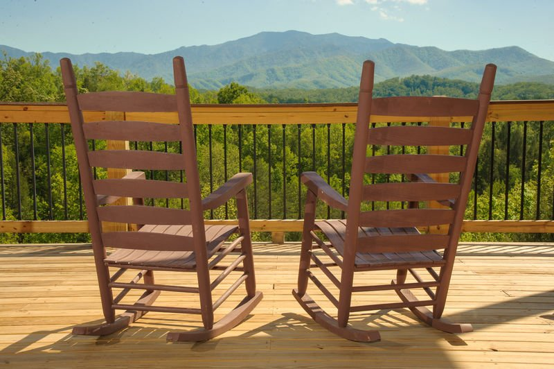 A Couple of Rocking Chairs in the Deck with Mountain View.