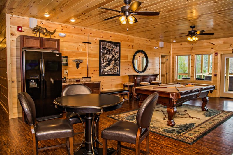 Game Room with Refrigerator, Wet Bar, Pool Table, Table, Chairs, and Stools.