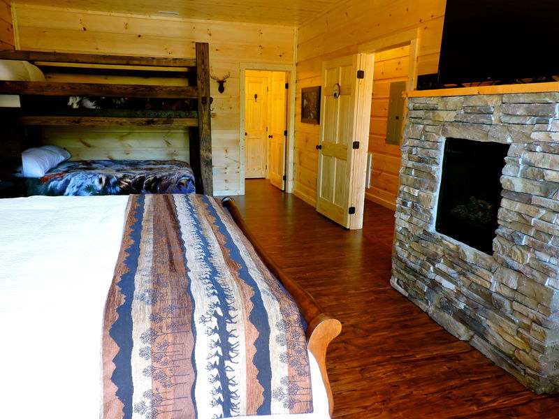 Fireplace, Large Bed, and Bunk Bed.