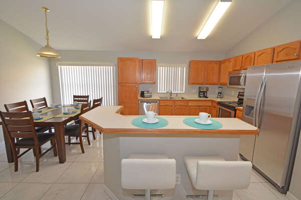 Kitchen with bar seating and table seating 6