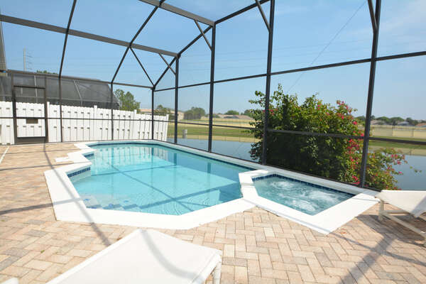 Pool overlooking lake to the rear
