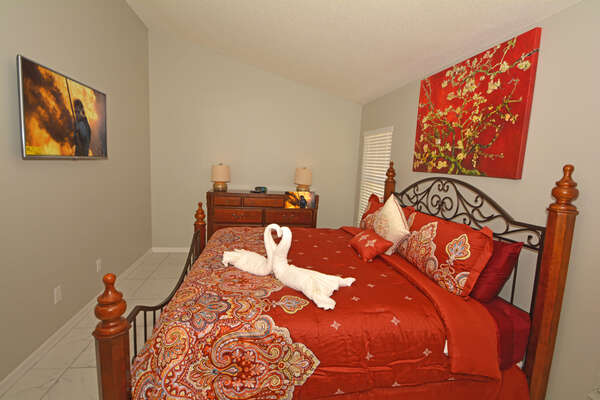 Master Bedroom 1 with wall mounted flatscreen TV and king size bed