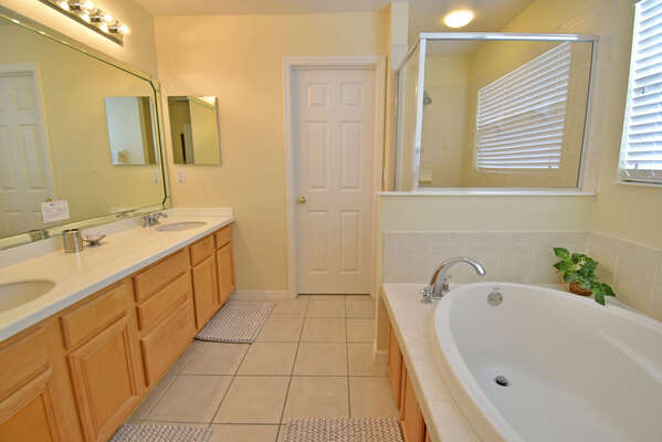 Master bathroom has an oval tub, separate shower, double basins and WC
