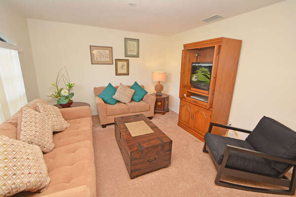 Formal seating area with comfortable seating and flatscreen TV & DVD