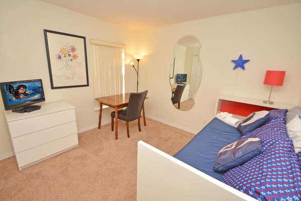 Bedroom 5 has day bed with pull out underneath, desk and flatscreen TV & DVD