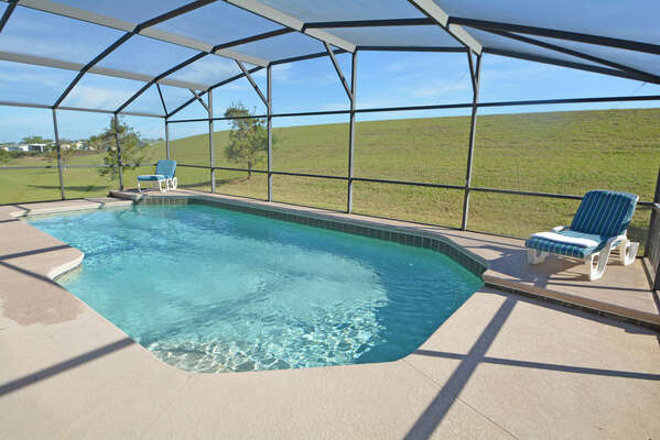 Pool and grass view beyond