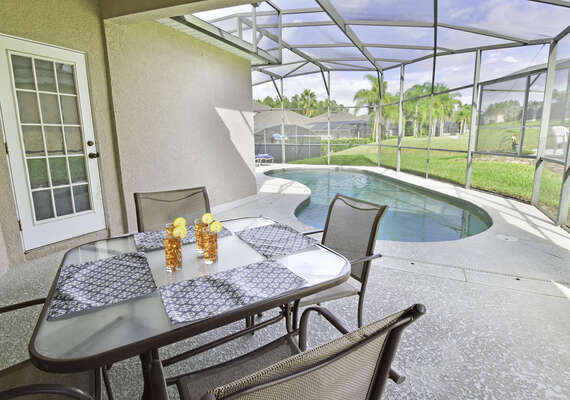 Shaded lanai area with patio table
