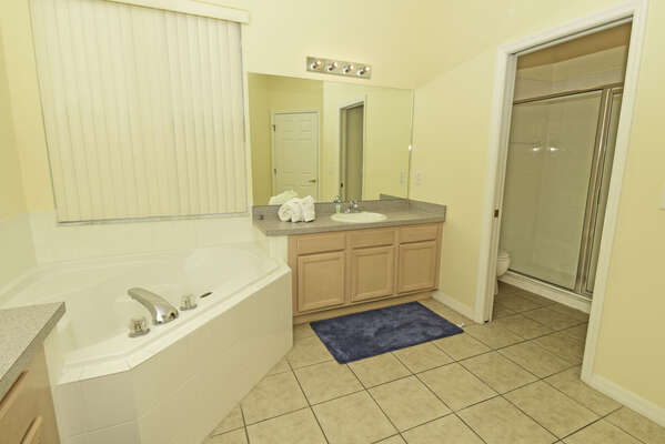 Master bathroom with double basins, tub and separate shower.