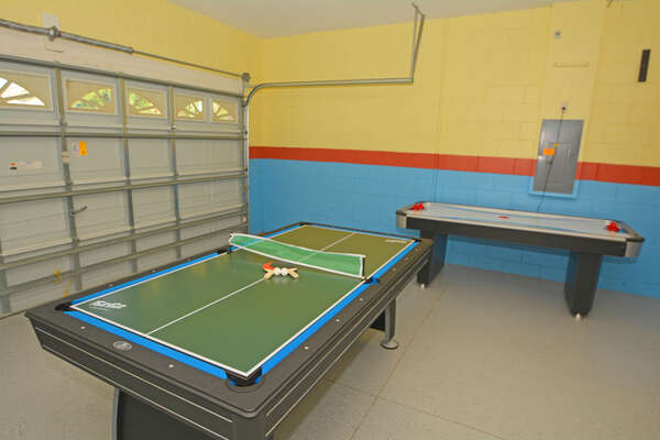 Garage converted to games room with pool table, ping pong topper and air hockey.