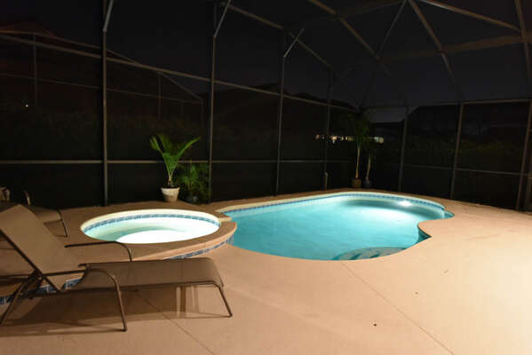large pool deck with pool and spa