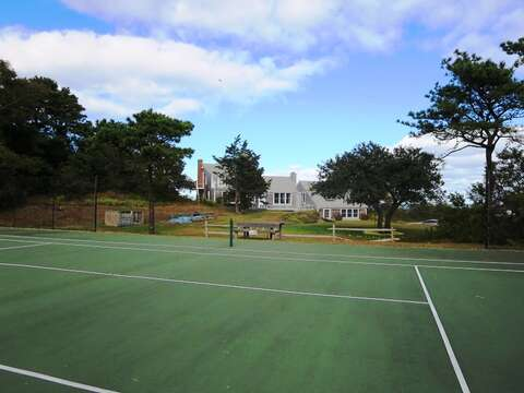 Play a round of tennis. Just steps across the yard from the house. Private court-play anytime. - 299 Cranberry Lane North Chatham Cape Cod New England Vacation Rentals