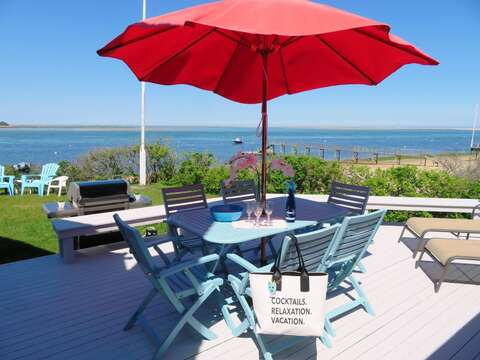 Deck off to the right of the living room as you face the water Outdoor dining and gas grill- 299 Cranberry Lane North Chatham Cape Cod New England Vacation Rentals