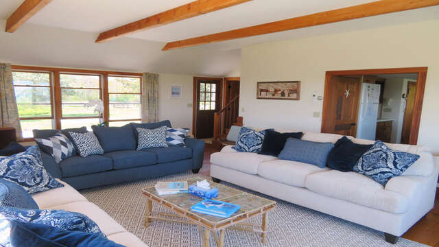 Living room with plenty of Comfy seating -door leads to front deck- 299 Cranberry Lane North Chatham Cape Cod New England Vacation Rental