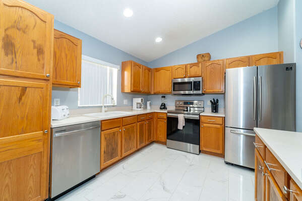 Kitchen has stainless steel appliances and is fully equipped