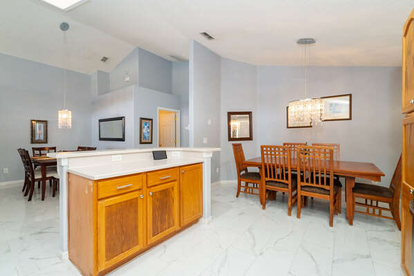 Kitchen showing both dining areas
