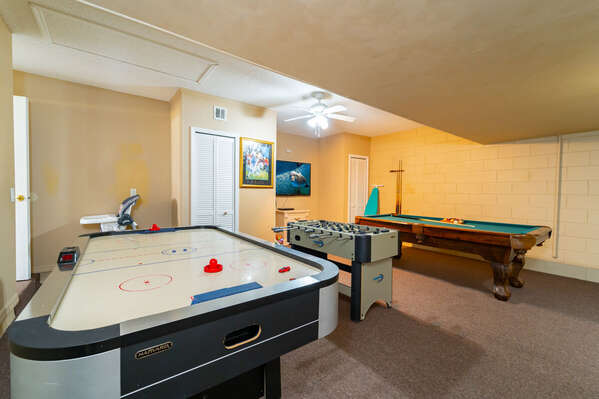 Garage converted to games room with air hockey, foosball and pool table
