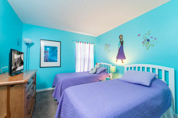 Bedroom 3 has a Frozen theme, twin beds and flatscreen TV