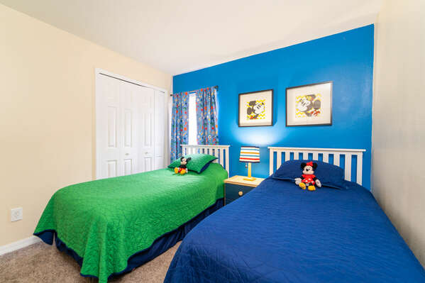 Bedroom 4 has a Disney theme and twin beds
