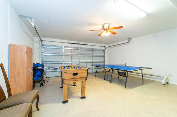 Garage converted to games room with foosball and ping pong tables