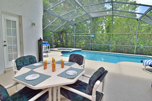 Shaded lanai with table seating four