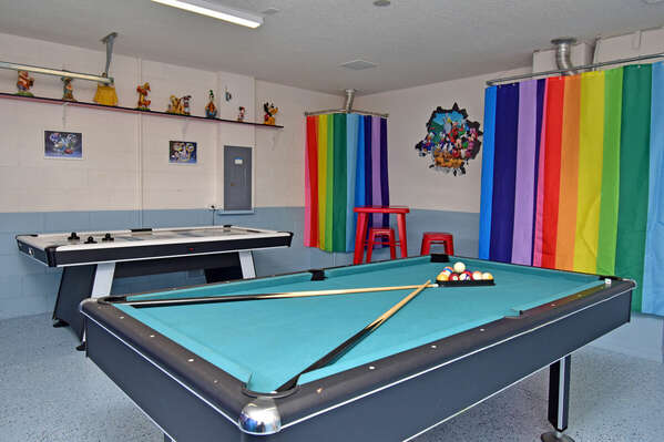 Games room with high top seating, air hockey and pool tables