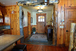 As you enter the Skye Lodge your eyes are drawn to the beautiful hand-hewn timbers accenting the lodge.