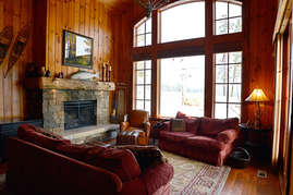 Cuddle up next to the warm fire and still be able to keep an eye on the slopes at Tamarack Resort.