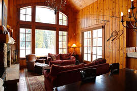 The living room offers plenty of seating and spectacular views for everyone.