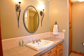 There is a tub/shower in the second bathroom and plenty of counter space for two guests.