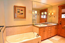 Relax in the large soaking tub in the master bathroom.