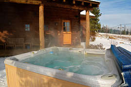 Enjoy the hot tub and take in the view of the slopes