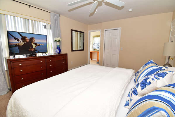 Master bedroom showing flatscreen TV and en-suite bathroom
