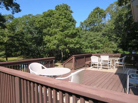 View of yard  from Back deck - 156 Beach Plum Lane Brewster Cape Cod New England Vacation Rentals