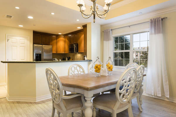 The dining area offers 6 chairs at the dining table and access to the kitchen