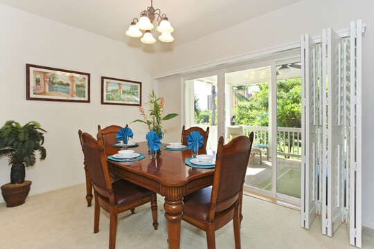 Dining Area with Wooden Table and Four Chairs.
