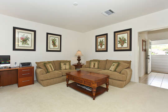 Enjoy a Spacious Living with Sofas, Coffee Table, and Desk.