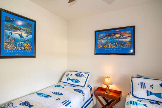 Art Work Featured in Bedroom with Twin-Sized Beds.