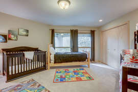 Wooden crib and changing table provided in room