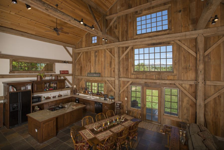 Open floor plan, and spectacular windows and wood beams