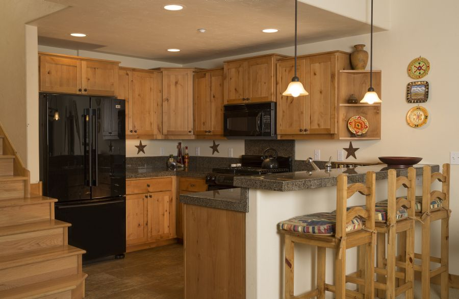 Kitchen opens to living and dining room