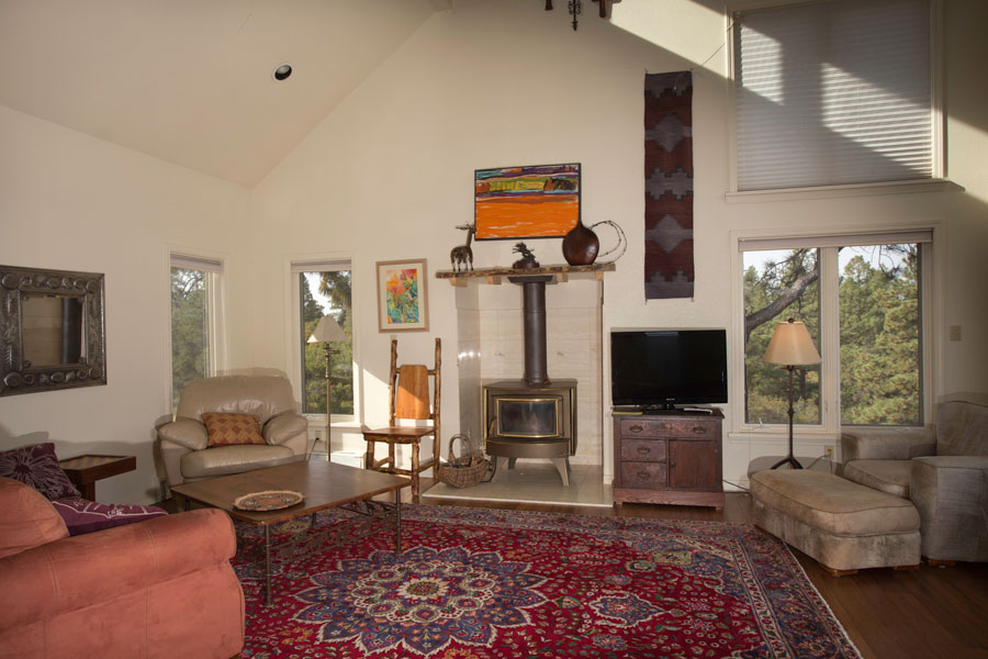 Living room with wood burning stove to keep you warm