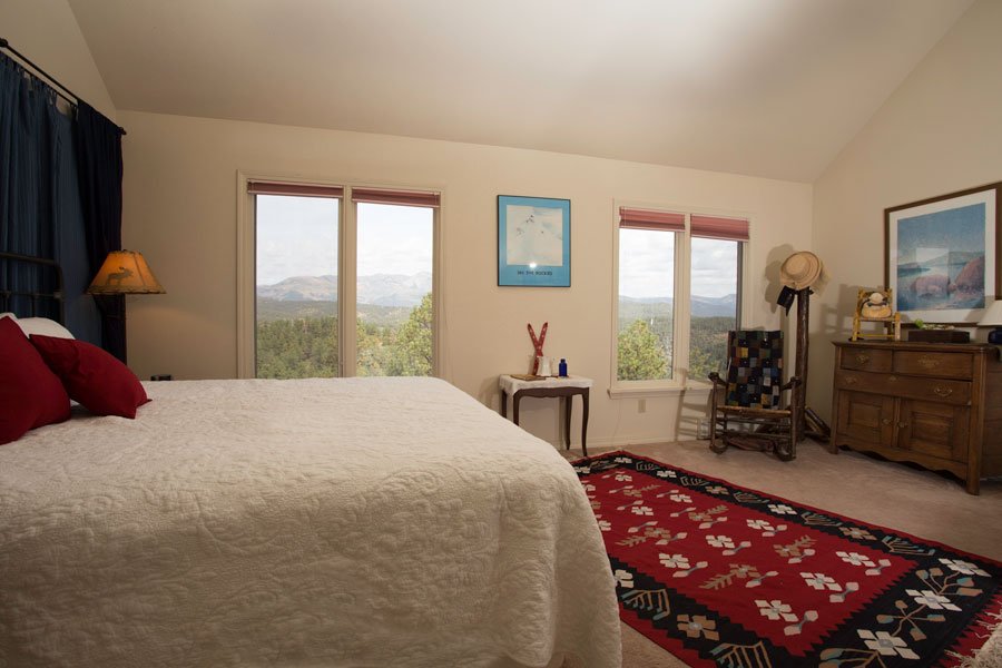 Master Bedroom with King and views!